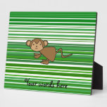 Cute monkey on green and white stripes plaques