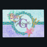 """Cute Monogram Mermaid Teal &amp; Purple Watercolor Placemat<br><div class=""""desc"""">Cute Watercolor mermaid,  shells,  trident,  scales and starfish with Initial Monogram &amp; Name in Purple,  Aqua &amp; Teal with bubbles and Gold Glitter Accents. A fun girly mermaid design with Personalized Text.</div>"""