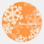 Cute orange and white Christmas snowflakes Classic Round Sticker
