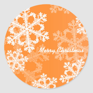 Cute orange and white Christmas snowflakes Classic Round Sticker