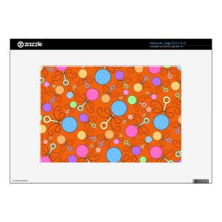 Cute orange baby rattle pattern skin for large netbook
