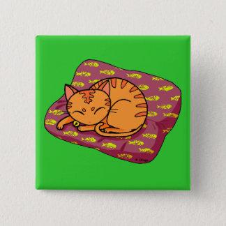 Cute orange cat sleeping button
