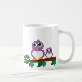 Cute owl and baby on tree coffee mug