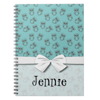 cute owl outlines on blue notebook