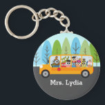 "Cute Owl School Bus Driver Keychain<br><div class=""desc"">This fun whimsical key chain features a yellow school bus with owls. The bus is going down a street lined with blue and green trees. Personalize this key chain with a name or appreciation quote. It&#39;s a simple inexpensive way to say thank you to your bus driver. This design can...</div>"