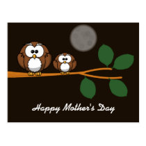 Cute owl with baby on green tree in moon light postcard