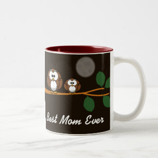 Cute owl with baby on green tree in moon light Two-Tone coffee mug