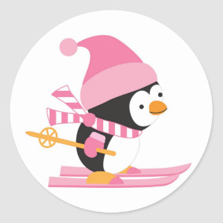 Cute Penguin on Snow Skis Classic Round Sticker