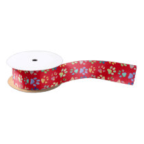 cute pet paw prints pattern on red satin ribbon