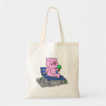 Cute pig sitting on a bench and eating ice cream tote bag