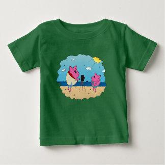Cute pigs on the beach. baby T-Shirt