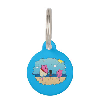 Cute pigs on the beach. pet tag