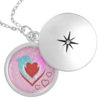 Cute pink blue dolphins holding a red heart round locket necklace