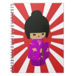 Cute Pink  Kawaii Kokeshi Doll on rising sun Notebooks