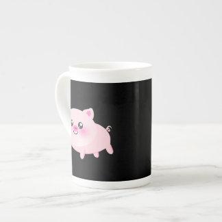 Cute Pink Pig on Black Tea Cup