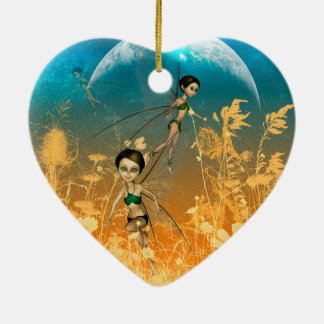 Cute playing and flying fairies in the night ceramic ornament