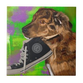 Cute Puppy Grabbing a Hi Top Sneaker Tile