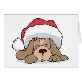 cute puppy in santa hat greeting card