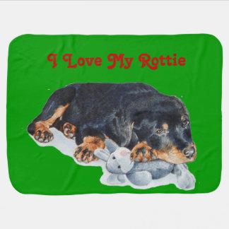 cute puppy rottweiler cuddling grey teddy bear stroller blanket