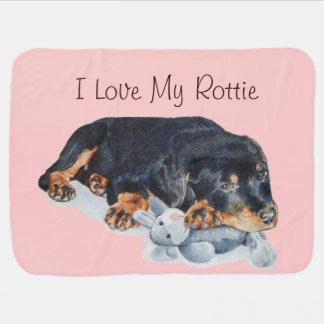 cute puppy rottweiler cuddling grey teddy bear swaddle blankets