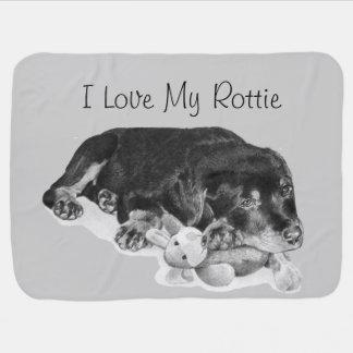 cute puppy rottweiler cuddling grey teddy bear stroller blankets