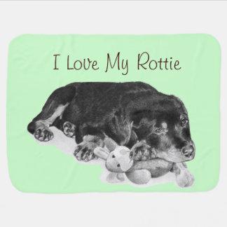 cute puppy rottweiler cuddling grey teddy bear baby blanket
