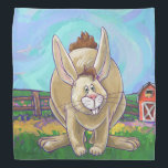 """Cute Rabbit Animal Parade Bandana<br><div class=""""desc"""">Fun Animal Parade Rabbit Gifts and Accessories features our original art of a tan and brown hare standing in a grassy field with red barn in the background and a textured blue sky with a playful wavy purple border. Our funny heads and tails bunny rabbit can be seen coming and...</div>"""