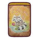 Cute raccoon with red apple near pond MacBook sleeve
