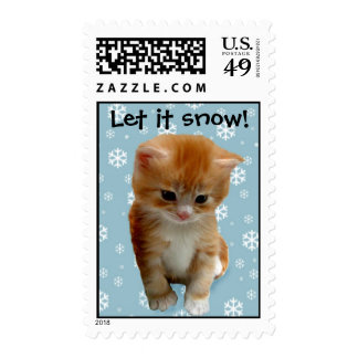 Cute red kitten on snow background postage