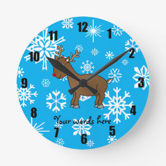 Cute reindeer blue and white snowflakes round clocks