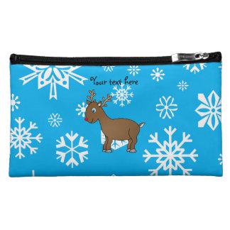 Cute reindeer sky blue and white snowflakes makeup bags