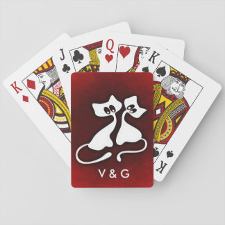 Cute romantic cat couple in love playing cards