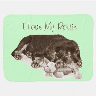 cute rottweiler puppy dog cuddling teddy bear art stroller blanket