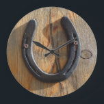 """Cute Rustic Western Good Luck Horseshoe Wood Look Large Clock<br><div class=""""desc"""">A charming Western equine good luck charm design. Western knotty wood grain look. PHOTOGRAPH of real wood art at the ranch looks 3-dimensional! Used lucky horseshoe is screwed to slab of weathered pine wood. Shadows cross the cracked wood with knots. Horseshoe from one of the happy horses living with She...</div>"""