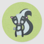 Cute Skunk with Flower on Green Classic Round Sticker