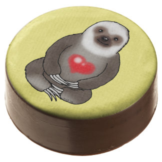 cute sloth with red heart chocolate covered oreo