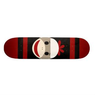 Cute Smiling Sock Monkey Face on Red Black Skate Boards