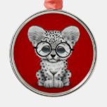 Cute Snow Leopard Cub Wearing Glasses on Red Round Metal Christmas Ornament