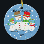 """Cute Snowman Family of 4 Christmas Ornament<br><div class=""""desc"""">Our family of 4 christmas ornament features a cute snowman couple set on a snow filled blue background!   Personalize with your information and date and you're all set to go!  Wonderful dated keepsake gift for your first christmas and a great addition to you christmas ornament collection.</div>"""