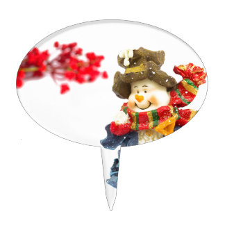 Cute snowman figurine with red berries on white cake topper