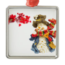 Cute snowman figurine with red berries on white metal ornament