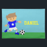 """Cute Soccer Star Boy, Football Theme Placemat<br><div class=""""desc"""">This cute dining placemat is great for boys who are soccer fans or football players! It comes with a cute boy in a trendy blue soccer jersey with star, white stripes on the sleeves, white shorts and matching blue football boots complete with studs getting ready to kick a soccer ball...</div>"""