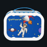 """Cute Space Walk Astronaut and Rocketship Lunch Box<br><div class=""""desc"""">A cute and fun design for kids with a deep blue galaxy background featuring stars,  planets and the moon. A spaceship or rocket in red,  white and blue orbits the solar system while a little boy spaceman or astronaut takes a moon walk.</div>"""