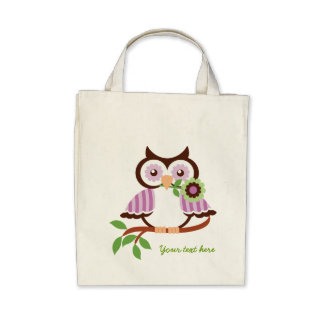 Cute spring owl holding a flower in her beak canvas bag