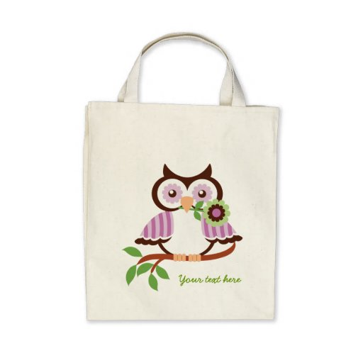 Cute spring owl holding a flower in her beak canvas bag