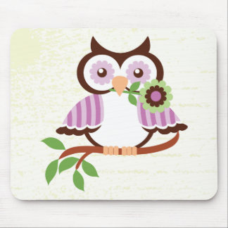 Cute spring owl holding a flower in her beak mouse pad