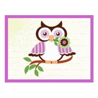 Cute spring owl holding a flower in her beak postcard
