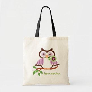 Cute spring owl holding a flower in her beak tote bag