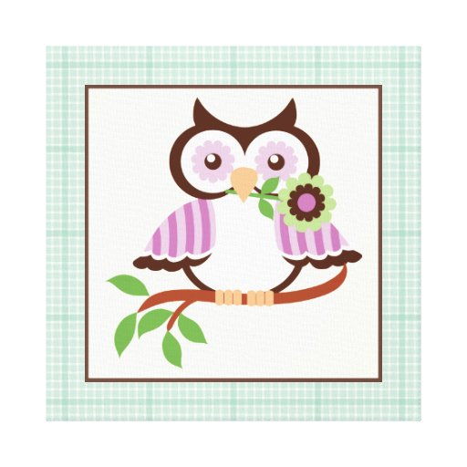 Cute spring owl on a branch wrapped canvas print