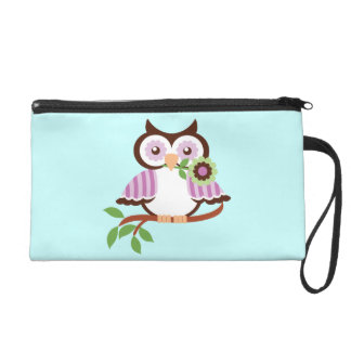 Cute spring owl on a branch wristlet